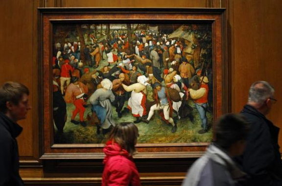 Visitors walk past Breughel's 'Wedding Dance' in the Detroit Intitute of Art