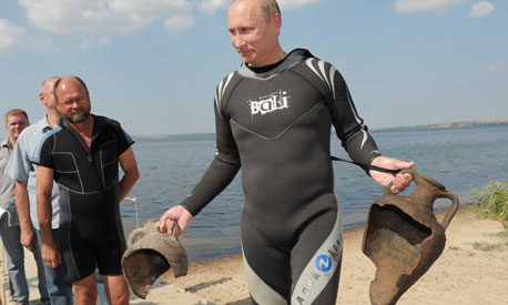 Vladimir Putin emerges form a dive at Phanagoria(the ancient Palace of Mithradates) in 2011 with 2 ancient urns.
