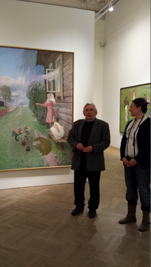Valentin Sidorov at the exhibition talking about 'May Rain.'