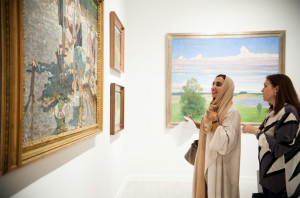 A lady considers the Tkachev brothers 1956 painting 'Laundresses' at an exhibition in Abu Dhabi.