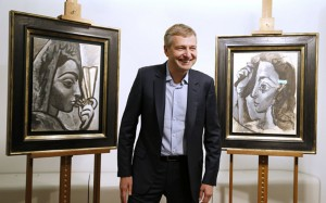 Dmitri Rybolovlev with the two allegedly stolen Picassos which he returned to the Picasso family.