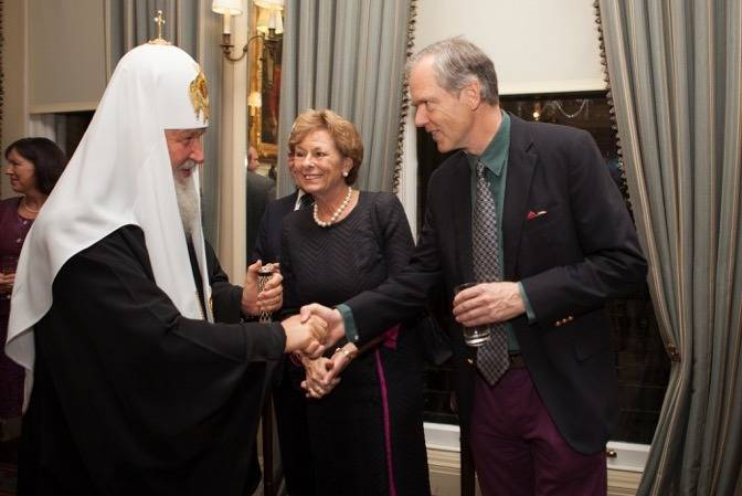 Ivan Lindsay and Lady Olga Maitland welcoming Patriarch Kirill of Moscow at the Cavalry and Guards Club in Piccadilly