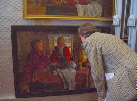 Stozharov - Ivan Lindsay examining a rare interior with figures round a table, October 2007
